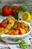 Rabbit stewed with vegetables in tomato sauce. Stock Photos