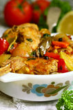 Rabbit stewed with vegetables in tomato sauce. Stock Image