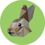 Rabbit in the style of the polygon. Fashion illustration of the. Trend in style on a green background. Icon, illustration for prints Royalty Free Stock Photos