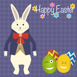 Rabbit in the suit and easter eggs Stock Image