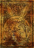 Rabbit symbol on antique texture background. Hair with mortar and pestle, baroque and floral decorations in fire circle Stock Images