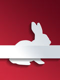 Rabbit symbol with label over red Stock Photos