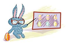Rabbit teacher with colorful easter eggs Royalty Free Stock Photos