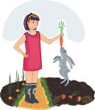 Rabbit the thief. A girl stands on a track near the beds of carrots and onions. She holds a carrot. For the tip of the carrot rabbit caught with his teeth Royalty Free Stock Photo