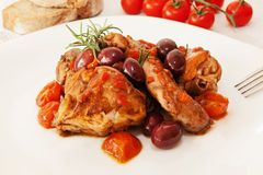 Rabbit tomato and olives. stock image