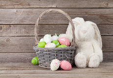 Rabbit toy and easter eggs basket Royalty Free Stock Image