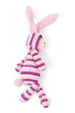Rabbit toy goes, closeup photo isolated on white Royalty Free Stock Photo