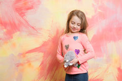 Rabbit toy in hand of girl, happy small child Stock Photo
