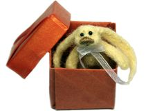 Rabbit toy in red box Stock Photos