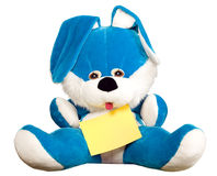 Rabbit toy is sitting and holding sheet of paper Stock Image