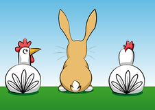Rabbit with two hens. A rabbit with two hens sitting on a meadow Royalty Free Stock Images