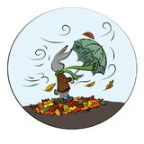 Rabbit with an umbrella for a walk on a windy autumn day.  Royalty Free Stock Photo