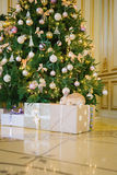 Rabbit under the Christmas tree Stock Images