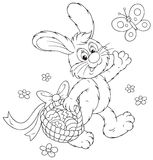 Easter Bunny with a basket of eggs Stock Photo