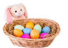 Rabbit and wattled basket with easter eggs Stock Photos