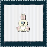 Rabbit on white frame with blue edges Royalty Free Stock Image