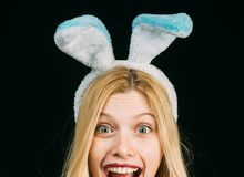 Rabbit woman wearing ears. Spring holiday. woman wearing a mask Easter bunny and looks very sensually. woman. Wearing a black Easter Bunny. Hunting eggs royalty free stock images