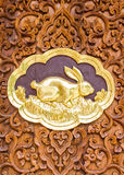 Rabbit wood Carving Wall sculptures in thai temple Royalty Free Stock Photo