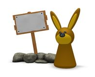 Rabbit and wooden sign Stock Photo