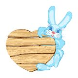 Rabbit with a wooden signboard Royalty Free Stock Photo