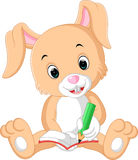 Rabbit writing on the book cartoon Royalty Free Stock Photos
