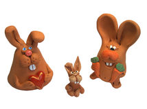 Rabbits 1. Happy rabbits family: father with carrot, mother with heart and fanny child royalty free stock image