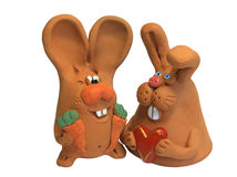 Rabbits 4. Happy rabbits family: father with carrot, mother with heart royalty free stock photos