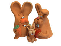 Rabbits 5. Happy rabbits family: father with carrot, mother with heart and fanny child royalty free stock photo