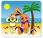 Rabbits on the beach. Vector illustration of rabbits with the ball on the beach Royalty Free Stock Image
