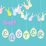 Rabbits bunting flag and eggs hanging Royalty Free Stock Image