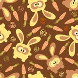 Rabbits and carrots seamless pattern Royalty Free Stock Photos