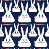 Rabbits with carrots. Seamless vector pattern. Animal background Stock Image
