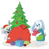 Rabbits and Christmas tree. Cartoon: rabbits, festive holiday decorations and gifts: Christmas tree, bag, gift boxes. Vector illustration Royalty Free Stock Photo