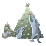 Rabbits and the Christmas tree Royalty Free Stock Images