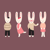 Rabbits in clothes Stock Photo