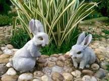 Rabbits Decorative garden Royalty Free Stock Images