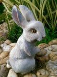Rabbits Decorative garden Stock Photography