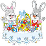 Rabbits with an Easter basket Royalty Free Stock Photo