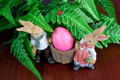 Rabbits and Easter eggs Stock Images
