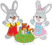 Rabbits with gifts Royalty Free Stock Photo