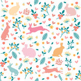 Rabbits in hearts and flowers. Royalty Free Stock Photo