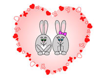 Rabbits in love. Two rabbits in love in a pink heart Stock Photo