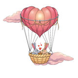 Rabbits in love on a balloon Stock Photography