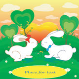 Rabbits love hearts vector card with place for text. Rabbits love hearts vector illustration for Valentine day or Easter Stock Photos
