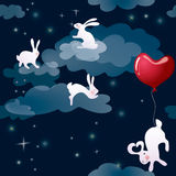 Rabbits in night sky Royalty Free Stock Photography