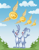 Rabbits observe the flight of dollars in the sky Royalty Free Stock Photos