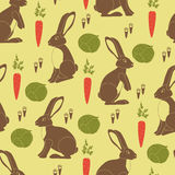 Rabbits, orange carrots, green cabbages and little footprints Stock Photo