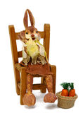 Rabbits papier sitting on chair straw Royalty Free Stock Images