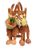 Rabbits papier sitting on chair straw Stock Photo