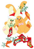 Rabbits prepare gifts for New Year. Rabbits are laid out gifts during the Christmas socks Royalty Free Stock Images